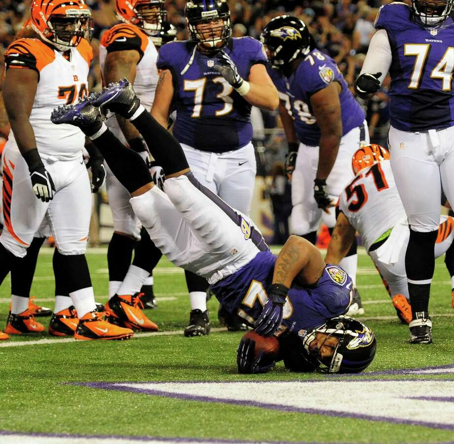 With some interested onlookers, Ravens RB Ray Rice dives into the end zone for his second touchdown. Photo: Gene Sweeney Jr. / Baltimore Sun