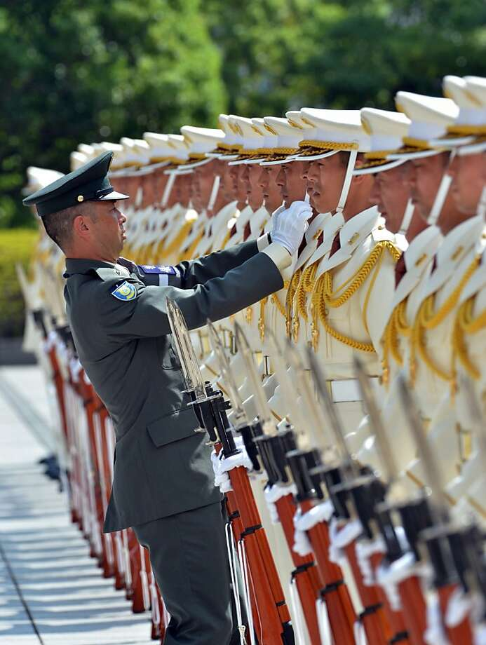 A defence ministry officer inspects honor guards at the Defence Ministry in Tokyo on September 11, 2012. Japanese Prime Minister Yoshihiko Noda delivered a speech before high-ranking officers of the defence ministry.   AFP PHOTO / Yoshikazu TSUNOYOSHIKAZU TSUNO/AFP/GettyImages Photo: Yoshikazu Tsuno, AFP/Getty Images