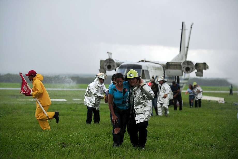 Nicaraguan firefighters held passengers during an air accident drill held at Managua's international airport, on September 10, 2012. AFP PHOTO/Hector RETAMALHECTOR RETAMAL/AFP/GettyImages Photo: Hector Retamal, AFP/Getty Images