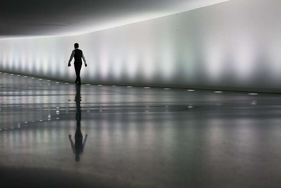 A staff member of the German parliament Bundestag walks through a tunnel between parliament buildings in Berlin, Monday, Sept. 10, 2012. During the first week after the summer break the German parliament will face the budget debate and on Wednesday a decision of Germany's Federal Constitutional Court about the European Stability Mechanism. (AP Photo/Markus Schreiber) Photo: Markus Schreiber, Associated Press