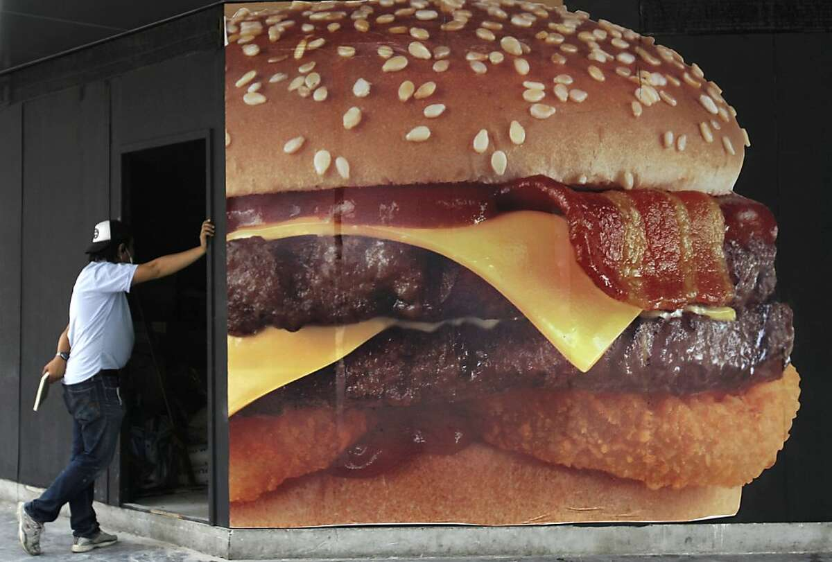 Free coronary stent with purchase: A burger joint boasts of some of the biggest and greasiest hamburgers in Bangkok.