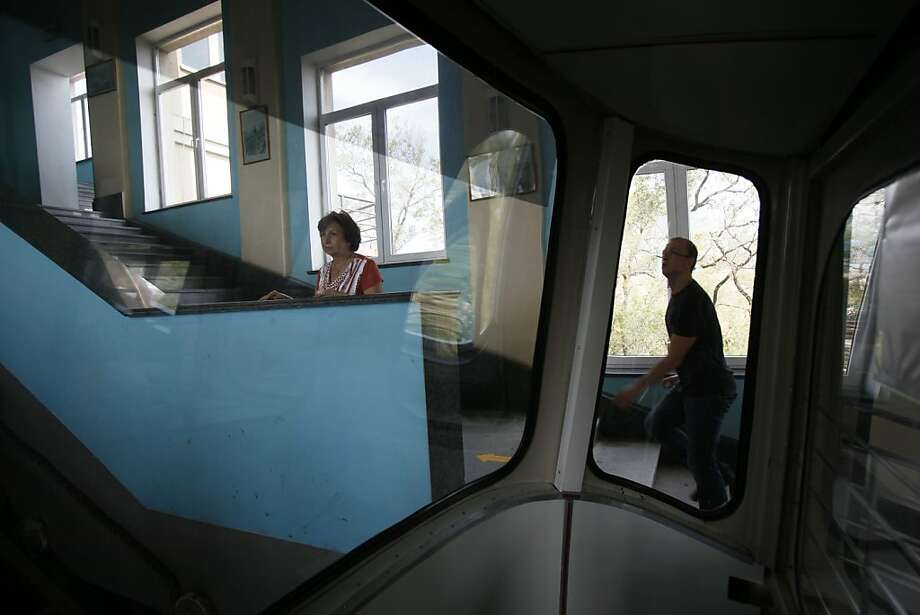A woman is seen through the window of a funicular in Vladivostok, Russia, Monday, Sept. 10, 2012. (AP Photo/Greg Baker) Photo: Greg Baker, Associated Press