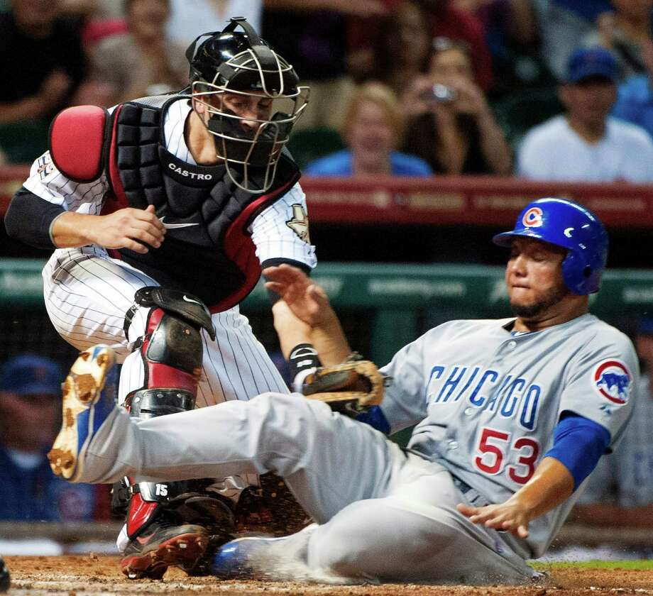 The Cubs' Welington Castillo (53) is tagged out by Astros catcher Jason Castro while trying to score on a single by Joe Mather in the fourth inning. Photo: Dave Einsel / FR43584 AP