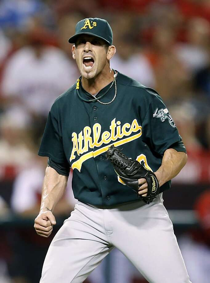Oakland Athletics relief pitcher Grant Balfour celebrates his team's 3-1 win against the Los Angeles Angels after a baseball game in Anaheim, Calif., Monday, Sept. 10, 2012. (AP Photo/Jae C. Hong) Photo: Jae C. Hong, Associated Press