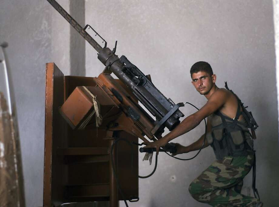 A Syrian rebel belonging to the Ahrar al Sham Battalions with an anti-aircraft gun rebels says he was used to shoot down a Syrian Air Force fighter jet in late August near Abu Dahour. Rebels in Abu Dahour have repeatedly attacked a military airport nearby. (David Enders/MCT)