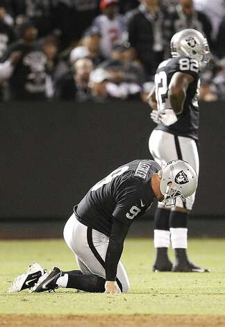Oakland Raiders punter Shane Lechler (9) kneels on the ground after having a punt blocked by San Diego Chargers tight end Dante Rosario during the second half of an NFL football game in Oakland, Calif., Monday, Sept. 10, 2012. (AP Photo/Tony Avelar) Photo: Tony Avelar, Associated Press