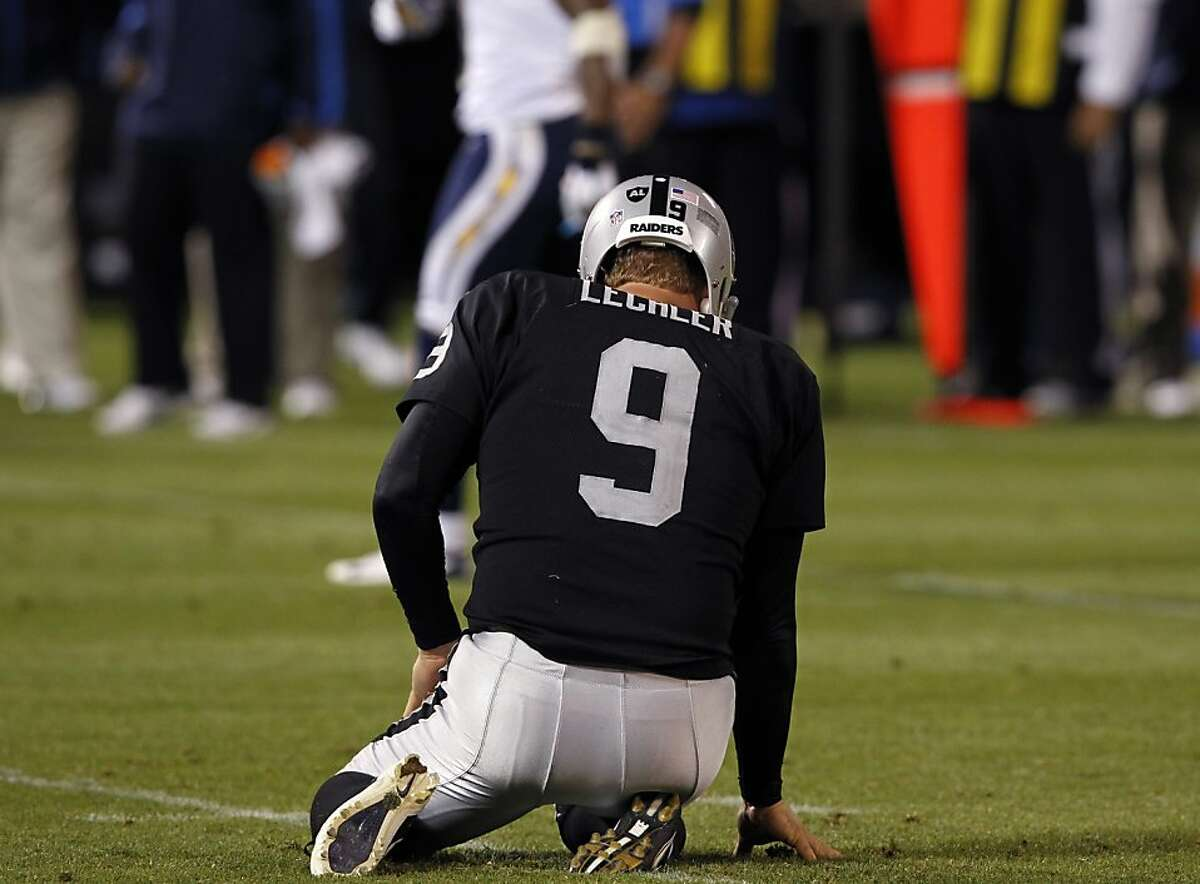 Punter Shane Lechler is slow getting up after his punt was blocked in the third quarter of the Oakland Raiders game against the San Diego Chargers in Oakland, Calif. on Monday, Sept. 10, 2012.