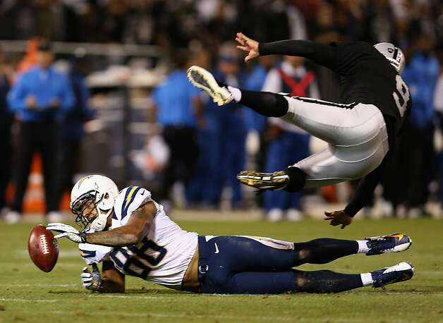 OAKLAND, CA - SEPTEMBER 10: Dante Rosario #88 of the San Diego Chargers blocks a punt attempt by Shane Lechler #9 of the Oakland Raiders during their season opener at Oakland-Alameda County Coliseum on September 10, 2012 in Oakland, California.  (Photo by Ezra Shaw/Getty Images) Photo: Ezra Shaw, Getty Images