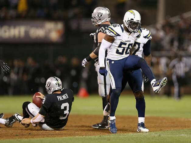OAKLAND, CA - SEPTEMBER 10: Donald Butler #56 of the San Diego Chargers celebrates after he sacked Carson Palmer #3 of the Oakland Raiders during their season opener at Oakland-Alameda County Coliseum on September 10, 2012 in Oakland, California.  (Photo by Ezra Shaw/Getty Images) Photo: Ezra Shaw, Getty Images