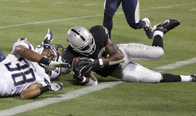 Oakland Raiders running back Darren McFadden (20) is tackled at the one-yard line against the San Diego Chargers during the second quarter of an NFL football game in Oakland, Calif., Monday, Sept. 10, 2012. (AP Photo/Ben Margot) Photo: Ben Margot, Associated Press