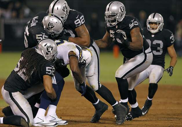 Oakland's defense keeps Antonio Gates from earning a first down in the third quarter of the Raiders game against the San Diego Chargers in Oakland, Calif. on Monday, Sept. 10, 2012. Photo: Paul Chinn, The Chronicle