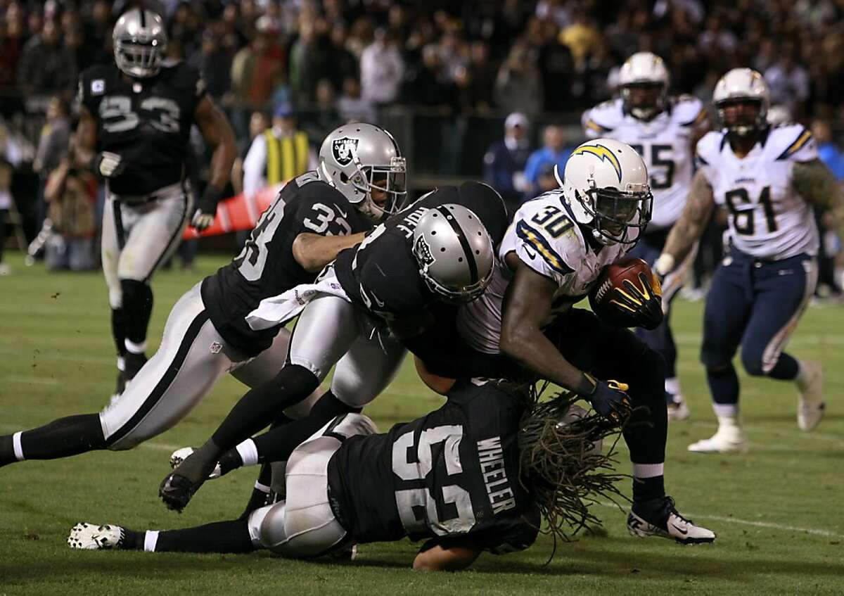 Runningback Ronnie Brown is stopped short of a first down in the third quarter of the Oakland Raiders game against the San Diego Chargers in Oakland, Calif. on Monday, Sept. 10, 2012.