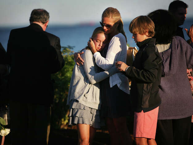 Sophie Pelletier-Martinelli, widow of 9/11 victim Michael Pelletier, hugs her daughter Sydney, 13, at the annual memorial service at Sherwood Island State Park in Westport on Monday, September 10, 2012. At right is Pelletier-Martinelli's son Nicolas, 11. Photo: Brian A. Pounds / Connecticut Post