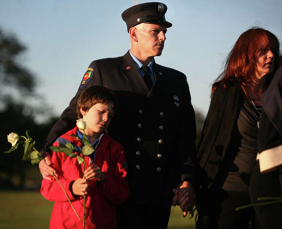 Glastonbury firefighter Martin VanRiper, wife Janine, and son Tyler, 9, of Glastonbury, visit the 9/11 memorial following the annual memorial service at Sherwood Island State Park in Westport on Monday, September 10, 2012. Janine's mother, Barbara Shaw, of New Jersey, was a victim in the 9/11 attacks. Photo: Brian A. Pounds / Connecticut Post