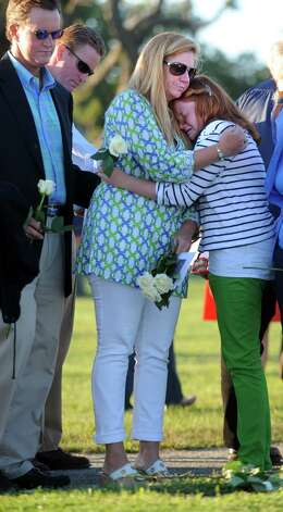Jennifer Hunt Bauman, of Essex, comforts her daughter Emma Hunt, 12, during the 11th annual 9/11 Memorial Service Monday, September 10, 2012 at Sherwood Island State Park in Westport, Conn.  William Christopher Hunt, of Norwalk, died in 2 Tower World Trade Center when Emma was just 15-months-old. Photo: Autumn Driscoll / Connecticut Post