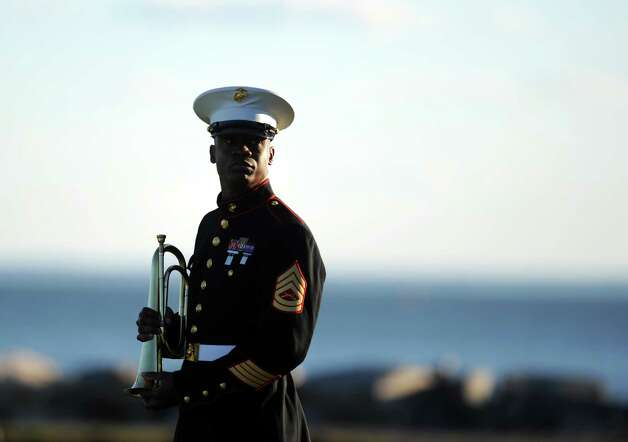 U.S. Marine Corps Gunnery Sergeant Orville Grizzle stands outside during ConnecticutâÄôs 11th Annual 9/11 Memorial Service Monday, September 10, 2012 at Sherwood Island State Park in Westport, Conn. Photo: Autumn Driscoll / Connecticut Post