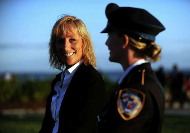 Jane Blackwell, of New Fairfield, smiles at her daughter Alex Blackwell, a Madison police officer, as they remember her late husband Chris Blackwell during ConnecticutâÄôs 11th Annual 9/11 Memorial Service Monday, September 10, 2012 at Sherwood Island State Park in Westport, Conn.  Chris Blackwell was a member of the New York City Fire Department's Rescue 3 and died on 9/11. Photo: Autumn Driscoll / Connecticut Post