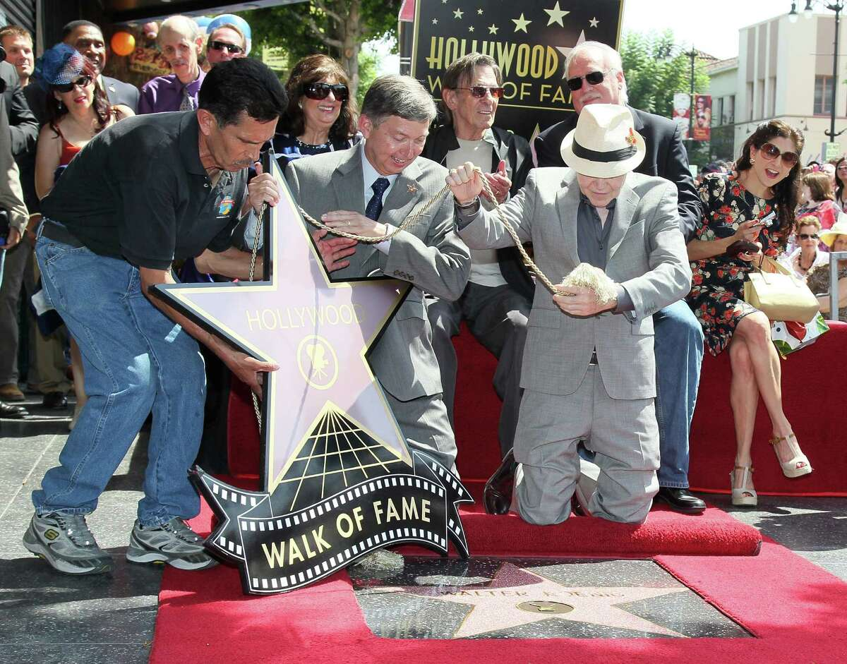 HOLLYWOOD, CA - SEPTEMBER 10: (L-R, front row) Walk of Fame assistant, Hollywood Chamber of Commerce president/CEO Leron Gubler and actor Walter Koenig and (L-R, 2nd row) writer Esther Shapiro, actor Leonard Nimoy and writers J. Michael Straczynski and Danielle Koenig attend Walter Koenig being honored with a Star on the Hollywood Walk of Fame on September 10, 2012 in Hollywood, California.
