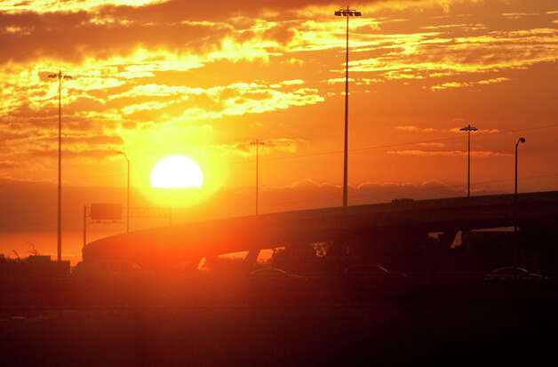 The sun rises over I-10 and Taylor Street Tuesday, Sept. 11, 2012, in Houston. (Cody Duty) Photo: Cody Duty, Houston Chronicle / © 2012 Houston Chronicle