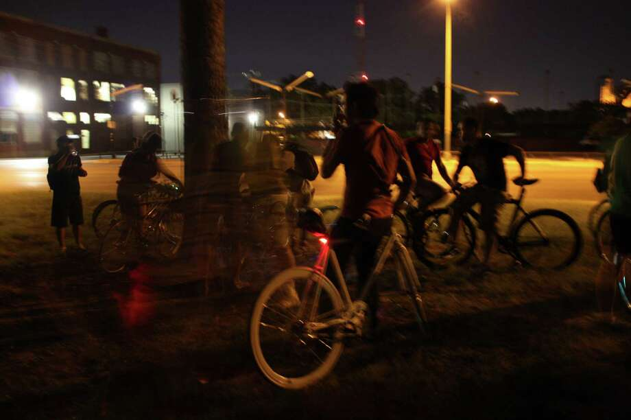 """Bicyclist rode from Maverick Park Monday night to the Alamo Drafthouse Park North to watch the movie """"Premium Rush"""". The event was organized by Bike Waiter. Photo: Libby Castillo"""