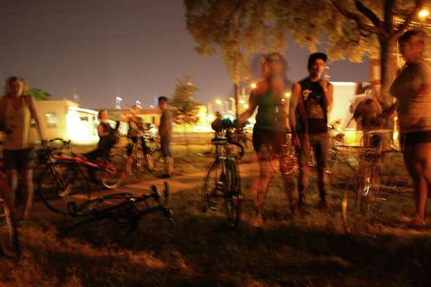 "Bicyclist rode from Maverick Park Monday night to the Alamo Drafthouse Park North to watch the movie ""Premium Rush"". The event was organized by Bike Waiter. Photo: Libby Castillo"