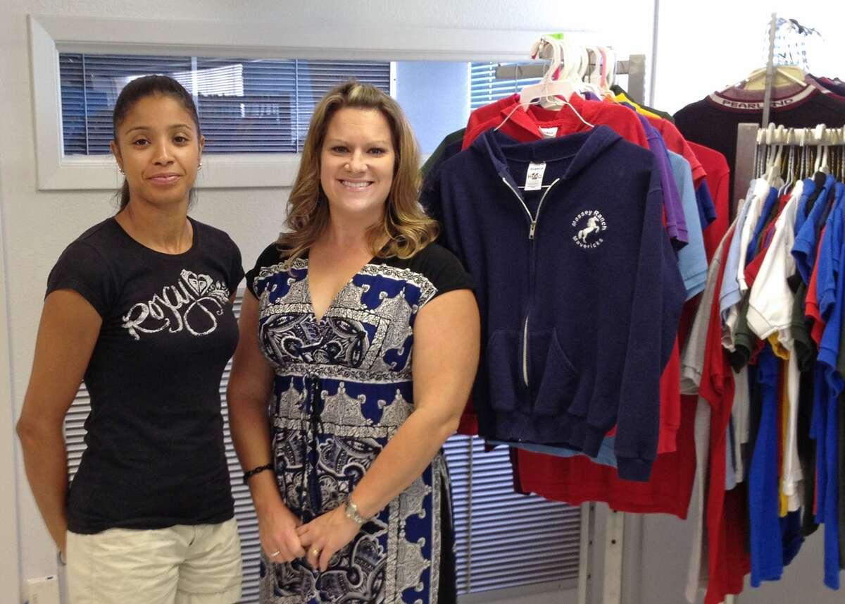 Community Closet and Swap Shop coordinators Tanya Green, left, and Frances Caballero prepare for the 2012-13 school year.