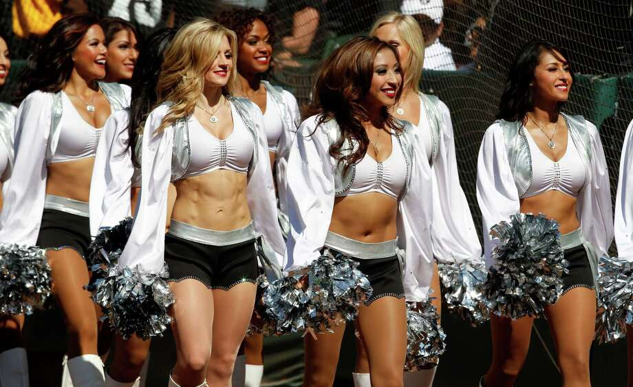Oakland Raiders cheerleaders perform during a preseason NFL football game in Oakland, Calif., Saturday, Aug. 25, 2012. (AP Photo/Tony Avelar) Photo: Tony Avelar, Associated Press / AP