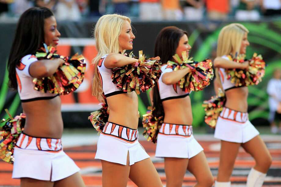 Cincinnati Bengals cheerleaders pose in the first half of an NFL football game against the Green Bay Packers, Thursday, Aug. 23, 2012, in Cincinnati. (AP Photo/Al Behrman) Photo: Al Behrman, Associated Press / AP