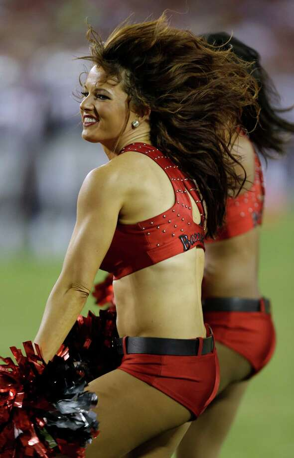 A Tampa Bay Buccaneers cheerleader during an NFL preseason football game against the New England Patriots Friday, Aug. 24, 2012, in Tampa, Fla. (AP Photo/Chris O'Meara) Photo: Chris O'Meara, Associated Press / AP