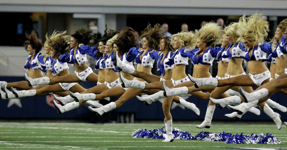 The Dallas Cowboys cheerleaders perform at the start of a preseason NFL football game against the St