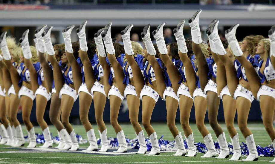 The Dallas Cowboys cheerleaders perform at the start of a preseason NFL football game against the St. Louis Rams Saturday, Aug. 25, 2012, in Arlington, Texas. (AP Photo/LM Otero) Photo: LM Otero, Associated Press / AP