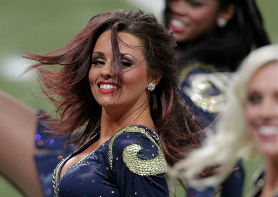 St. Louis Rams cheerleaders perform during the first quarter of a preseason NFL football game between the St. Louis Rams and the Baltimore Ravens Thursday, Aug. 30, 2012, in St. Louis. (AP Photo/Tom Gannam) Photo: Tom Gannam, Associated Press / FR45452 AP