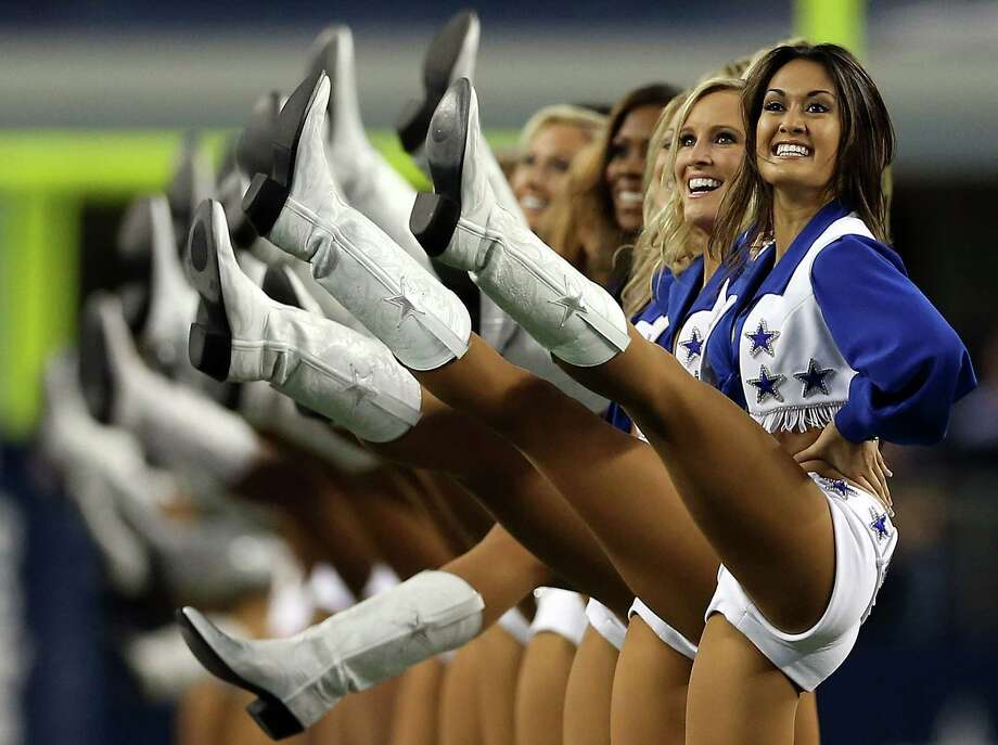 ARLINGTON, TX - AUGUST 29:  The Dallas Cowboys Cheerleaders perform at Cowboys Stadium on August 29, 2012 in Arlington, Texas. Photo: Ronald Martinez, Getty Images / 2012 Getty Images