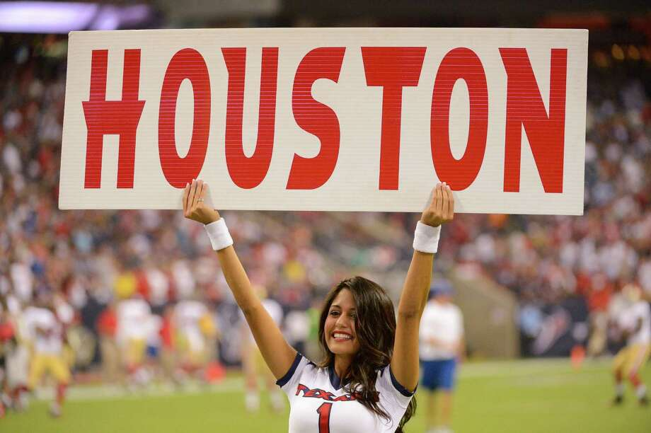 Houston Texans cheerleaders perform before an NFL preseason football game against the San Francisco 49ers, Saturday, Aug. 18, 2012, in Houston. The Texans beat the 49ers 20-9. (AP Photo/Dave Einsel) Photo: Dave Einsel, Associated Press / FR43584 AP