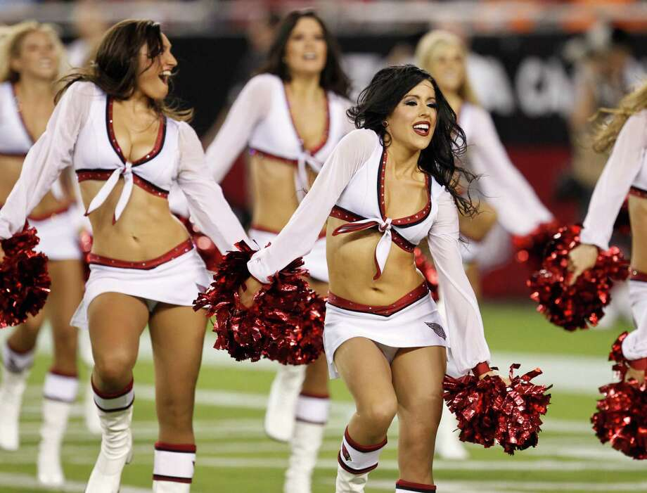 The Arizona Cardinals cheerleaders perform during the first half of an NFL preseason football game against the Denver Broncos, Thursday, Aug. 30, 2012,in Glendale, Ariz. (AP Photo/Ross D. Franklin) Photo: Ross D. Franklin, Associated Press / AP