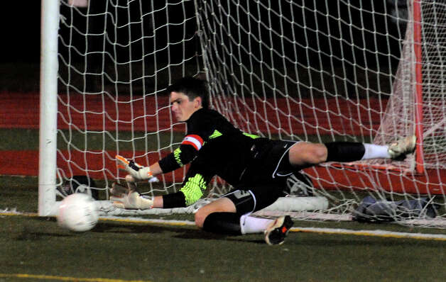 Staples goalie James Hickock stops a New Canaan goal attempt for the win, during FCIAC boys' soccer semi-finals action in Fairfield, Conn. on Wednesday November 2, 2011. Photo: Christian Abraham / Connecticut Post