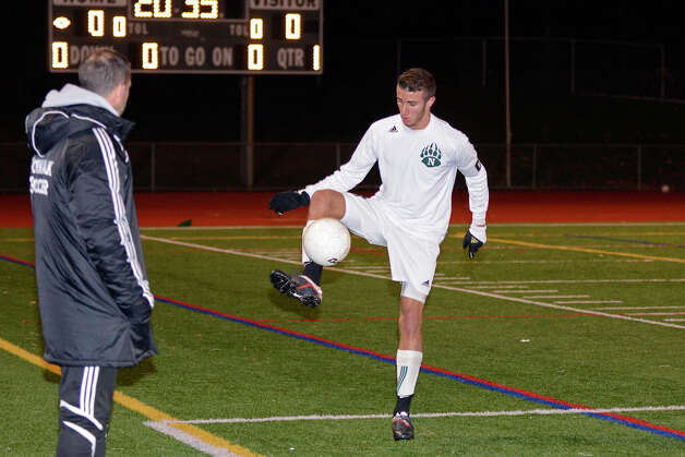 Norwalk's Andrew Melitsanopoulos controls the ball as Norwalk High School hosts Farmington HIgh School in boys soccer in Norwalk, CT on Thurs., November 17, 2011. Photo: Shelley Cryan / Shelley Cryan freelance; Connecticut Post freelance