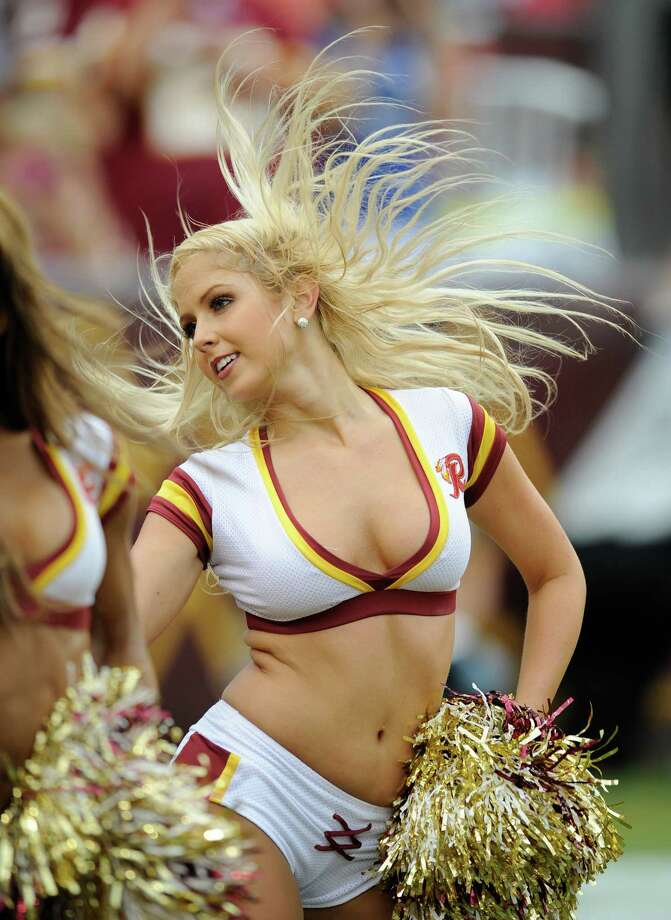 Washington Redskins cheerleaders perform before an NFL preseason football game with the Indianapolis Colts Saturday, Aug. 25, 2012, in Landover, Md. (AP Photo/Nick Wass) Photo: Nick Wass, Associated Press / FR67404 AP