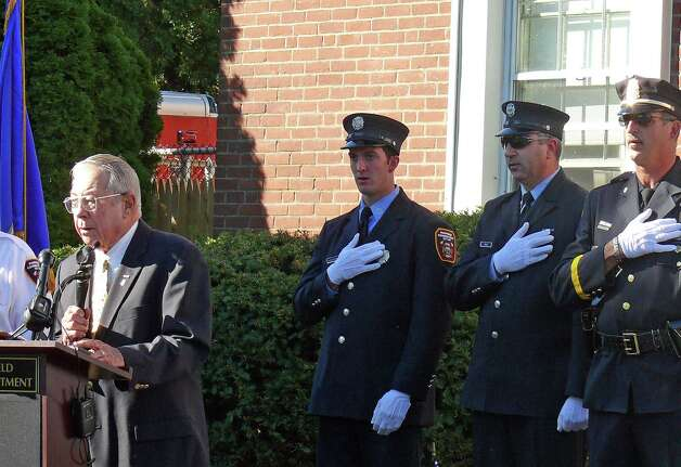 Former Fire Chief David Russell leads participants in the Pledge of Allegiance Tuesday at ceremonies marking the 11th anniversary of the Sept. 11 terrorist attacks. Photo: Genevieve Reilly / Fairfield Citizen