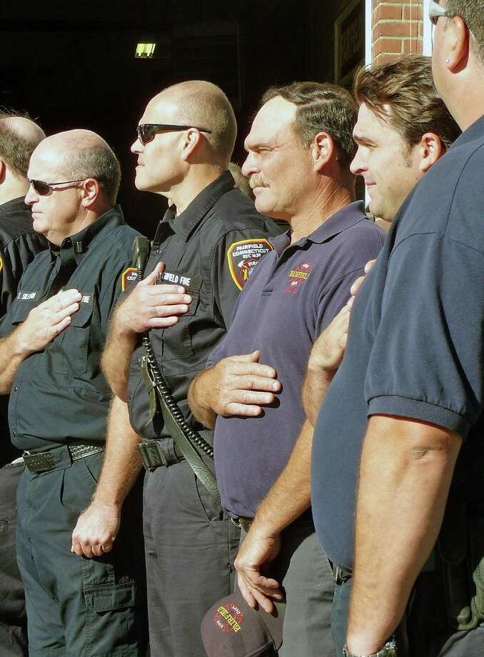 Fairfield firefighters during Tuesday's ceremony marking the 11th anniversary of the Sept. 11 terrorist attacks. Photo: Genevieve Reilly / Fairfield Citizen