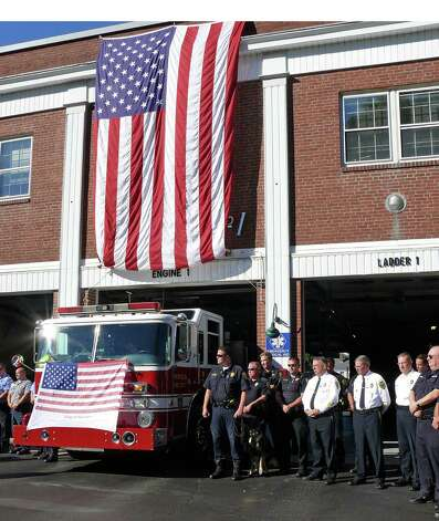 The town held its annual ceremony Tuesday marking the 11th anniversary of the Sept. 11 terrorist attacks. Photo: Genevieve Reilly / Fairfield Citizen