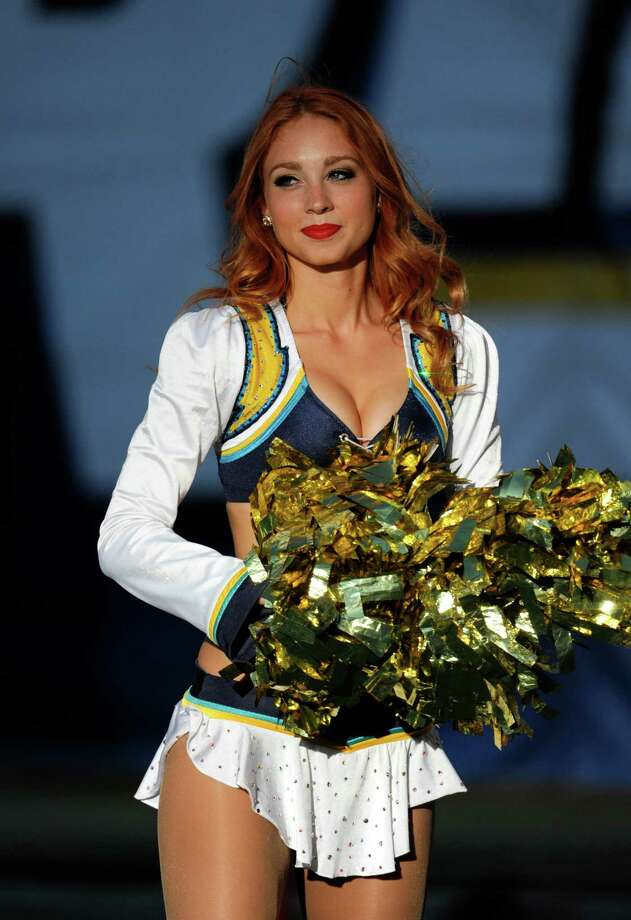 A San Diego Chargers cheerleader performs during the first half  of a NFL preseason football game Saturday, Aug. 18, 2012 in San Diego. (AP Photo/Denis Poroy) Photo: Denis Poroy, Associated Press / FR59680 AP