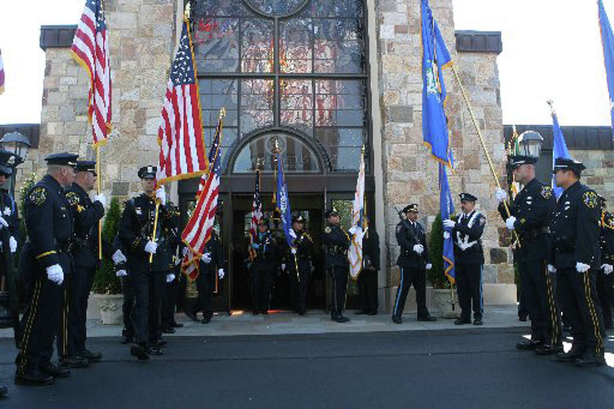 Area law enforcement, fire and emergency medical service personnel attend the annual Diocesan Blue Mass at Saint Aloysius Roman Catholic Church on Sunday, September 9, in New Canaan, Conn. The mass commemorates the eleventh anniversary of 9-11. Photo by B.K. Angeletti for the Connecticut Post