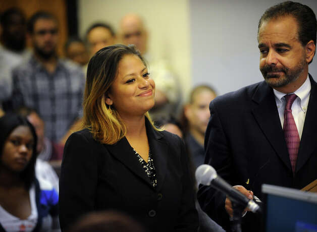 State House candidate Christina Ayala and her lawyer Guy P. Soares appear in Superior Court in Bridgeport on Monday, September 11, 2012. Ayala is facing charges after police siad she fled the scene of an accident the night of August 15. Photo: Brian A. Pounds / Connecticut Post