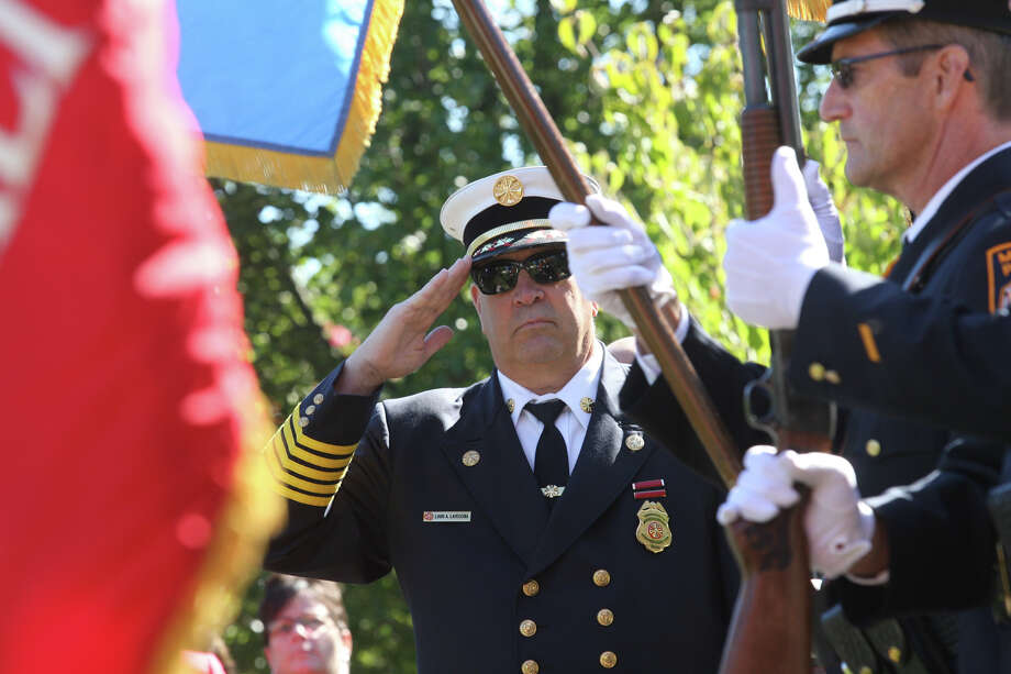 Fire Chief Lou LaVecchia salutes  during a 9/11 remembrance ceremony at Live Oaks School in Milford, Conn. on Monday. September 11, 2012. Photo: B.K. Angeletti / Connecticut Post freelance B.K. Angeletti