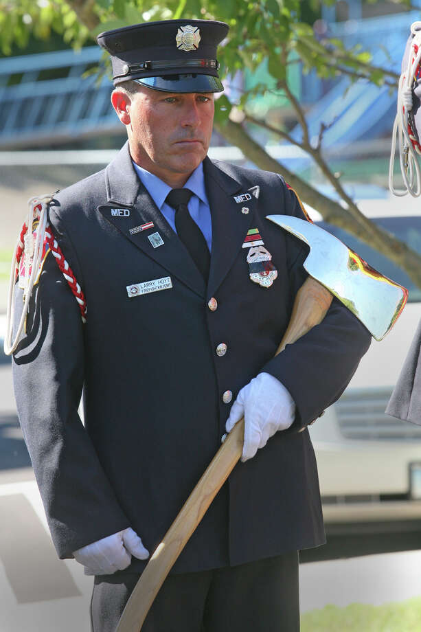 Larry Hoyt holds an axe as part if the Milford Honor Guard during a 9/11 remembrance ceremony at Live Oaks School in Milford, Conn. on Monday. September 11, 2012. Photo: B.K. Angeletti / Connecticut Post freelance B.K. Angeletti