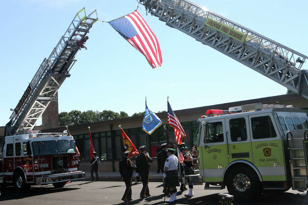 The Milford Honor Guard retreats after a 9/11 remembrance ceremony at Live Oaks School in Milford, Conn. on Monday. September 11, 2012. Photo: B.K. Angeletti / Connecticut Post freelance B.K. Angeletti