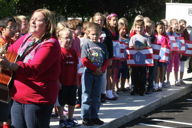 Music teacher Lisa Gloates leads students in song during a 9/11 remembrance ceremony at Live Oaks School in Milford, Conn. on Monday. September 11, 2012. Photo: B.K. Angeletti / Connecticut Post freelance B.K. Angeletti