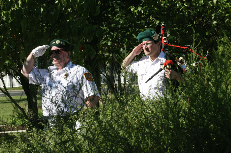 New Haven county Firefighters Emerald Society members, Dan Worroll, left, and Jason Hall, salute during a 9/11 remembrance ceremony at Live Oaks School in Milford, Conn. on Monday. September 11, 2012. Photo: B.K. Angeletti / Connecticut Post freelance B.K. Angeletti
