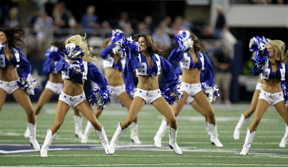 Members of the Dallas Cowboys cheerleaders perform before a preseason NFL football game against the Miami Dolphins Wednesday, Aug. 29, 2012, in Arlington, Texas. (AP Photo/LM Otero) Photo: LM Otero, Associated Press / AP